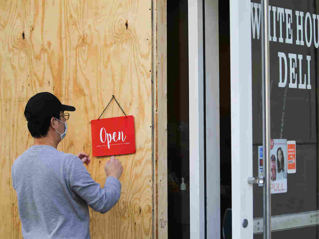 WASHINGTON, D.C., USA - NOVEMBER 2, 2020: A restaurant with the front windows boarded up in case of street riots during the upcoming 2020 general elections.