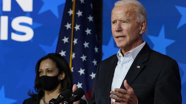 Joe Biden speaks Thursday in Wilmington, Del., with Sen. Kamala Harris at his side. World leaders reacted to Biden