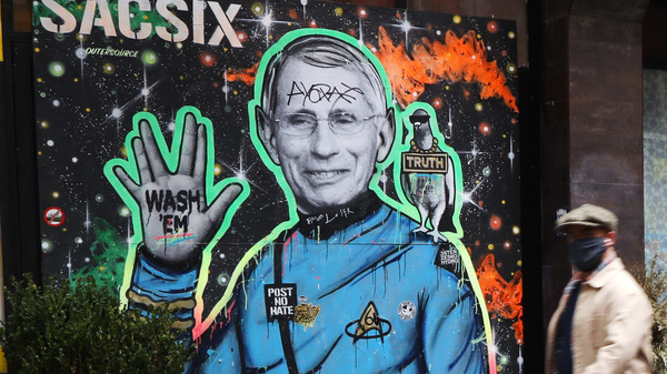 """Dr. Anthony Fauci, seen here depicted in a mural in New York City, is """"a proud son of Brooklyn"""" who is helping the country get through the COVID-19 pandemic, Brooklyn Borough President Eric Adams said."""