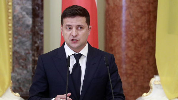 Ukrainian President Volodymyr Zelenskiy speaks during a joint news briefing with Polish President Andrzej Duda in Kyiv, last month. A spokeswoman for Zelenskiy says that he has been hospitalized for COVID-19.