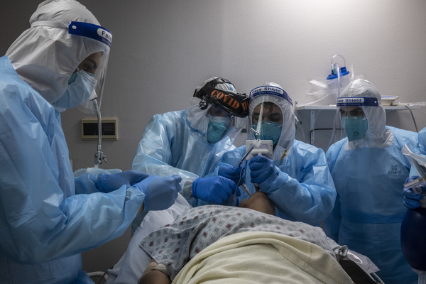 Medical staff treat a patient in the COVID-19 intensive care unit at the United Memorial Medical Center in Houston on Nov. 10.