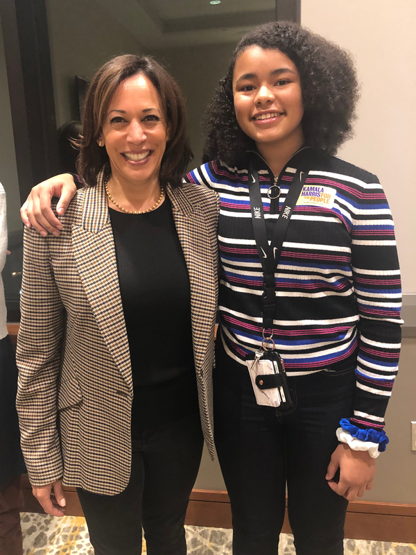 Harris poses with Paris Bond, then age 13, at a meeting of supporters in Muscatine, Iowa, last year.