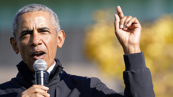 """Former President Barack Obama speaks at a rally for Joe Biden in Flint, Mich. on Oct. 31. In an interview with NPR, Obama said Trump was """"denying reality"""" by refusing to concede the election to Biden."""