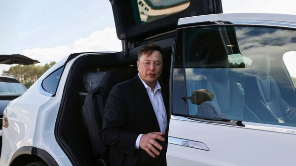 Tesla CEO Elon Musk sits in his car before visiting the construction site of a future Tesla factory near Berlin on Sept. 3. Musk said on Twitter he has tested both positive and negative for the coronavirus.