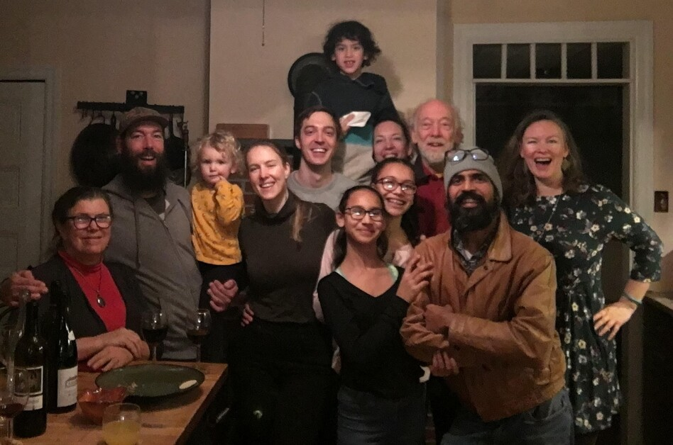Jasmine Surti (far right) and three generations of her family celebrating Thanksgiving in Philadelphia in 2018. From left, front: Louise Aucott, Gabe Aucott with Juniper Chamberlin, Rachel Aucott, Sandhya Surti, Anjali Surti, Hemant Surti, Jasmine Surti 2nd row, starting from center: Steve Hoenstine, Aimee Landau, Mike Aucott Top: Ezra Landau.