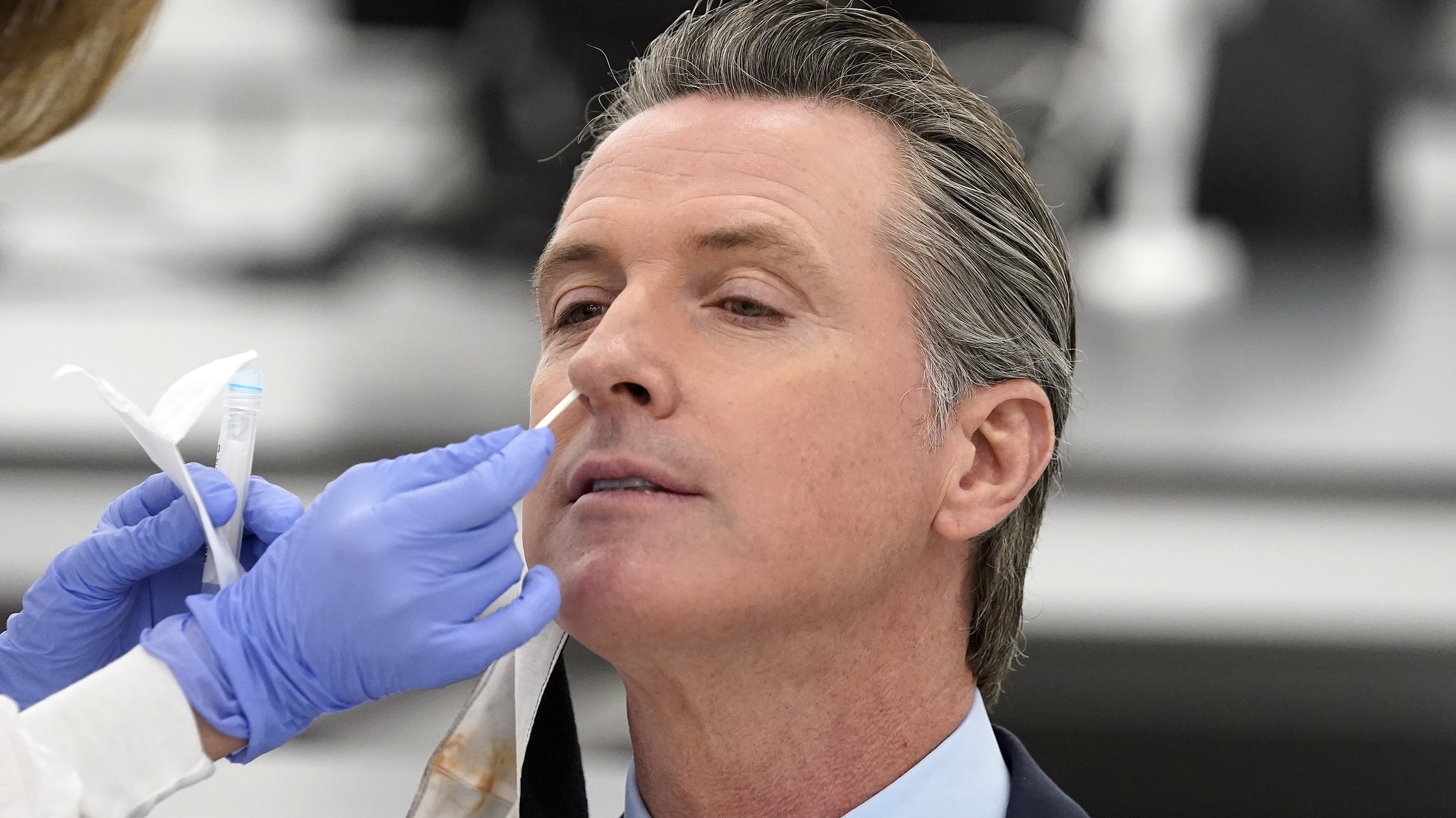 """California Gov. Gavin Newsom, pictured receiving a coronavirus test on Oct. 30, apologized to residents on Monday for attending a birthday party with too many guests. """"I need to preach and practice, not just preach,"""" he said."""