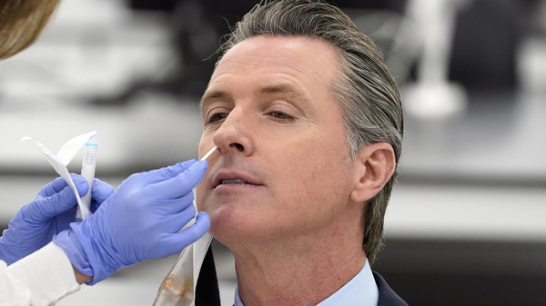 """California Gov. Gavin Newsom, pictured receiving a COVID-19 test on Oct. 30, apologized to residents on Monday for attending a birthday party with too many guests. """"I need to preach and practice, not just preach,"""" he said."""