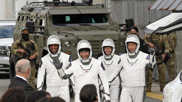 Astronauts, from left, Victor Glover, Michael Hopkins, Shannon Walker, and Japan