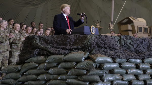 President Trump speaks to U.S. troops at Bagram Air Field, Afghanistan, on Thanksgiving Day 2019. The Trump administration says it