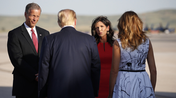 Sen. John Thune, R-S.D., and Gov. Kristi Noem greet President Donald Trump and first Lady Melania Trump upon arrival at Ellsworth Air Force Base on July 3, 2020, in Rapid City, S.D. Trump was en route to Mount Rushmore National Memorial.