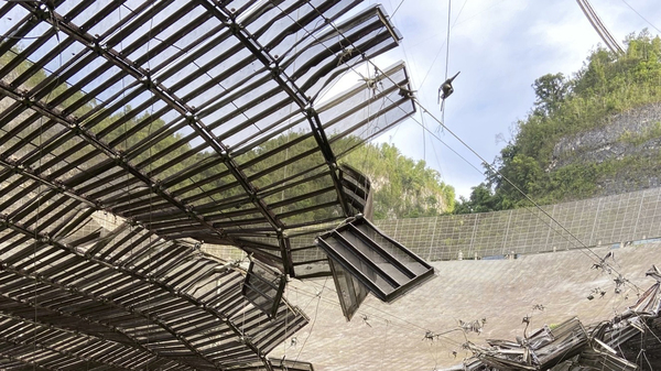 In August a broken cable that supported a metal equipment platform created a 100-foot (30-meter) gash to the Arecibo radio telescope