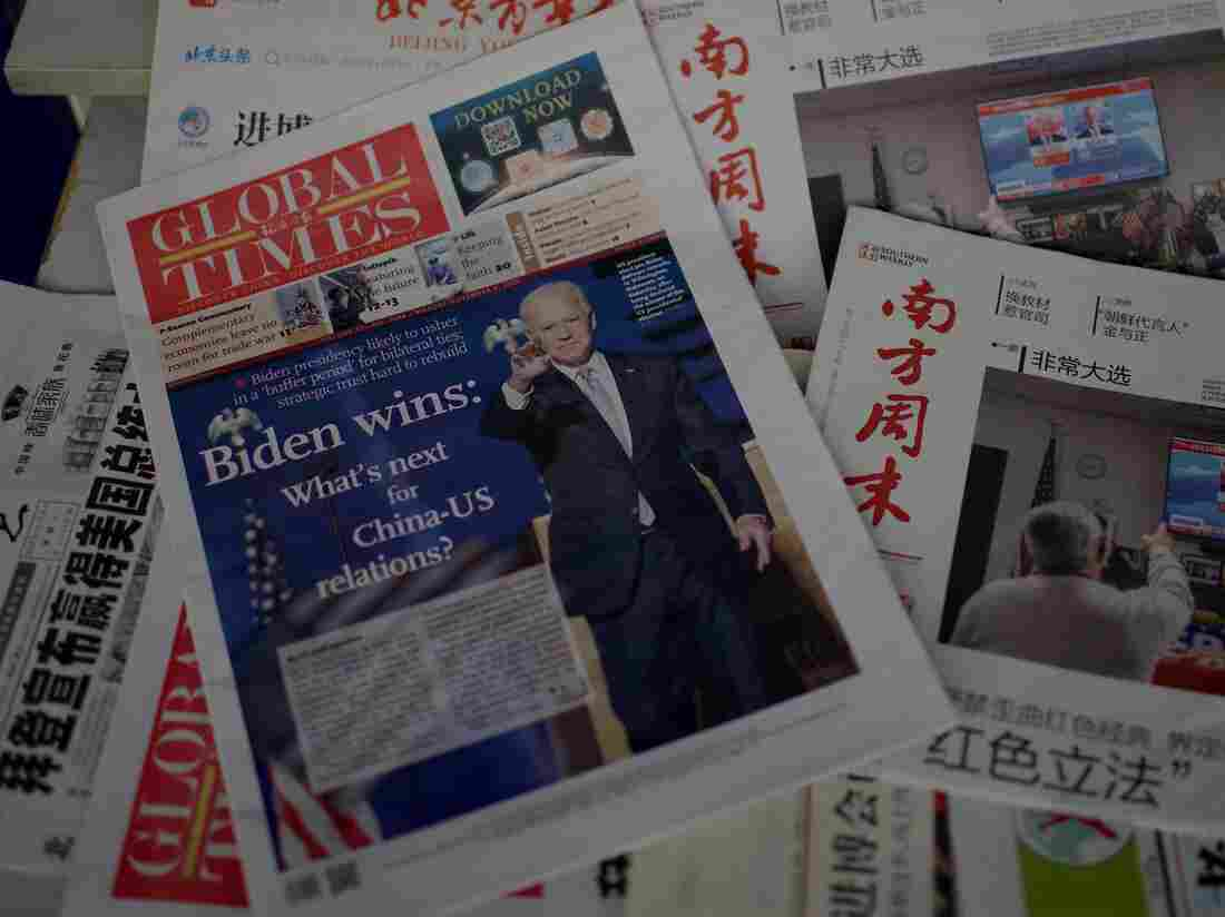 Newspaper front pages lead with the victory of Joe Biden in the US presidential election, at a news stand in Beijing on November 9, 2020.