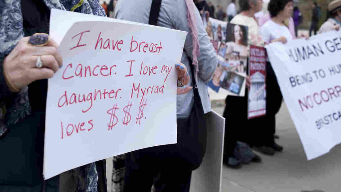 """UNITED STATES - APRIL 15: Members of """"Breast Cancer Action"""" protest against Myriad Genetics in front the U.S. Supreme Court as arguments start for Association for Molecular Pathology v. Myriad Genetics. The case calls into question whether human DNA can be claimed as intellectual property, and remain off limits to everyone without the permission of the patent holder."""