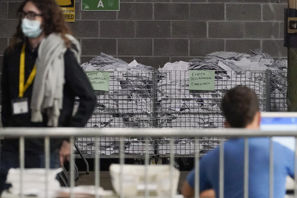 Election office workers process ballots at the Allegheny County elections returns warehouse in Pittsburgh, earlier this month. (Gene J. Puskar/AP)