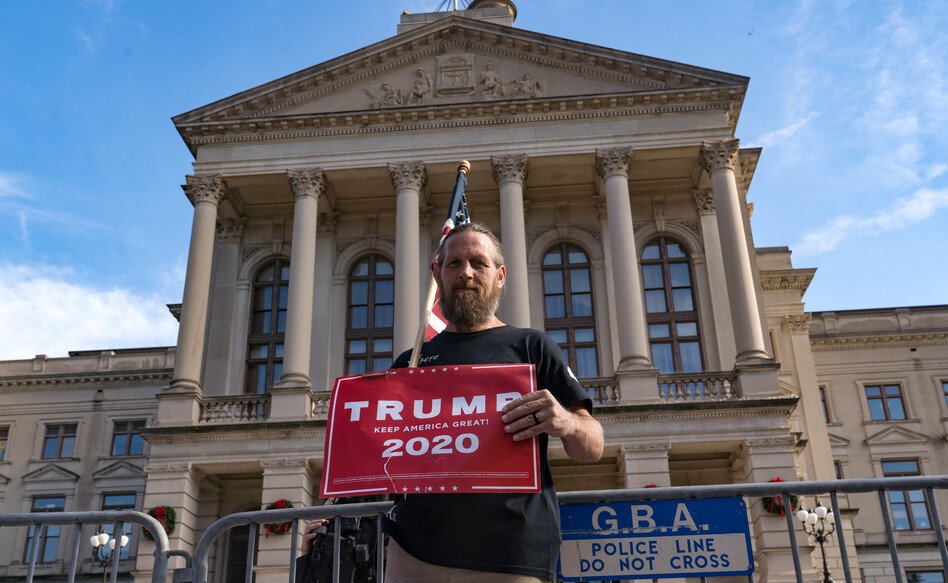 A supporter of President Trump protests outside the Georgia State Capitol on Saturday in Atlanta. The president's campaign has requested a vote recount in the state. (Megan Varner/Getty Images)