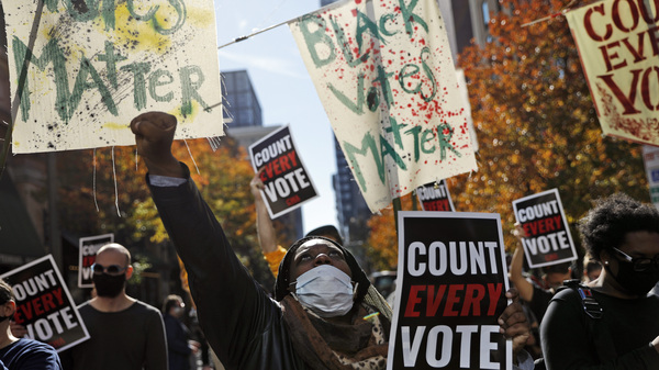 Zhanon Morales, 30, of Philadelphia, raises her fist during a Nov. 5 voting rights rally. President Trump's campaign unsuccessfully used spurious claims of voter fraud to invalidate votes in Philadelphia and other largely Black cities.