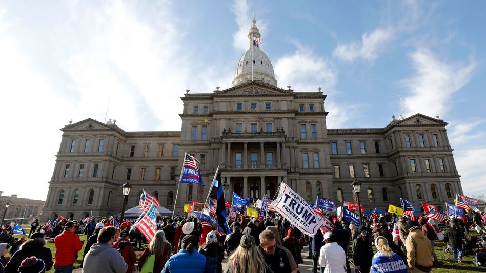 Protesters gather in support of President Trump on Nov. 14 at the Michigan Capitol in Lansing. Trump and his allies have baselessly alleged widespread voter fraud was to blame for the president's election loss. (Jeff Kowalsky/AFP via Getty Images)