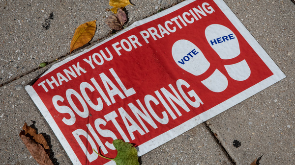 """A social distancing sign on the ground. """"Social distancing"""" was one of dozens of terms highlighted by researchers in Oxford Languages"""