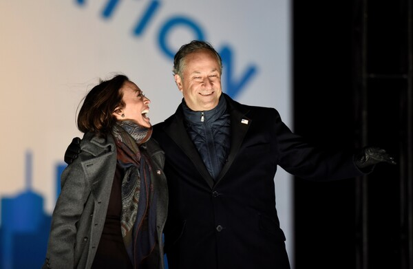 Doug Emhoff joins his wife, Kamala Harris, for a get-out-the-vote rally Nov. 2 in Philadelphia. With Harris set to become vice president, Emhoff has said he will give up his career, for now, to serve as second gentleman.