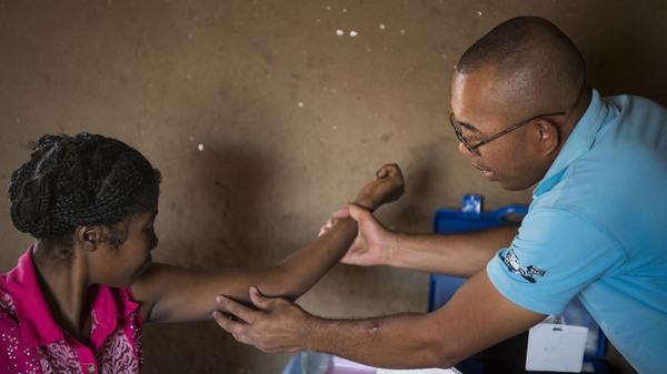 Nana (left) gets her birth control implant checked by Dr. Jean Rangomana during the Marie Stopes International mobile clinic in Besakoa, Madagascar, on April 9, 2018. Abortion is illegal under all circumstances in Madagascar, and Trump administration policies led to shortages of birth control there, health workers say.
