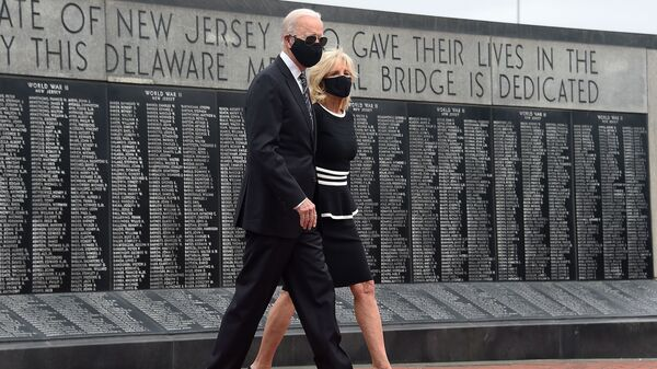Joe Biden and his wife Jill Biden wear masks as they mark Memorial Day, on May 25. The president-elect has consistently worn masks amid the pandemic, and is calling for a national mask mandate.