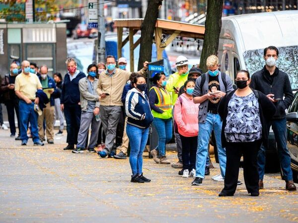 With new infections rising all over the country, states are struggling to slow the spread and testing can barely keep up. People line up outside a Covid-19 testing site in New York on November 11, 2020.