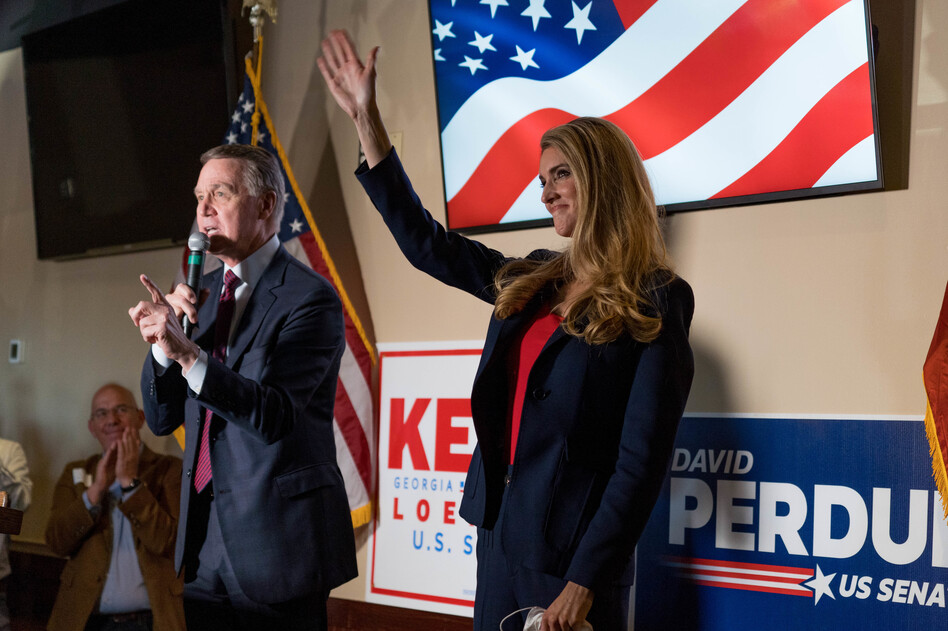 Sens. David Perdue and Kelly Loeffler speak at a campaign event this month at a restaurant in Cumming, Ga. Both are competing in runoff elections in January that will determine which party controls the Senate.