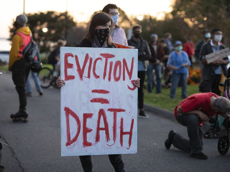 Housing activists gather in Swampscott, Mass., in October to call on the state's governor to support more robust protections against evictions and foreclosures during the pandemic. (Michael Dwyer/AP)