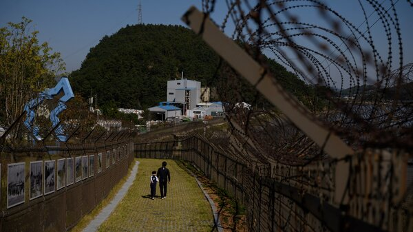 A North Korean man defected to South Korea by hopping a fence along the Demilitarized Zone separating the two countries.