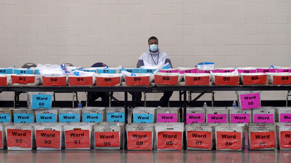 An election officials pauses during the ballot recount earlier this month at the Wisconsin Center in Milwaukee, Wis. Officials in Milwaukee County, where President Trump had demanded a recount, said that Joe Biden's lead actually increased on review.