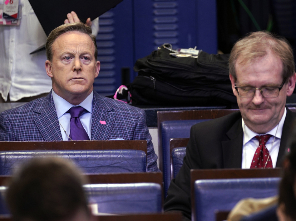 Sean Spicer (left), the former White House press secretary and an on-air personality for Newsmax, listens during a March coronavirus task force briefing at the White House. (Evan Vucci/AP)