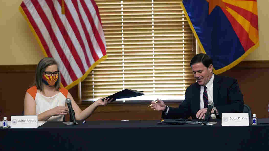 Arizona, Wisconsin certify election; Trump may challenge results