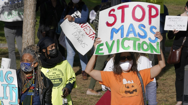 Protesters call for support for tenants and homeowners at risk of eviction during a demonstration on Oct. 11 in Boston. A federal moratorium on evictions is set to expire at the end of December.
