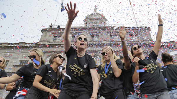 Megan Rapinoe (center) and Alex Morgan (right), pictured celebrating with U.S. women