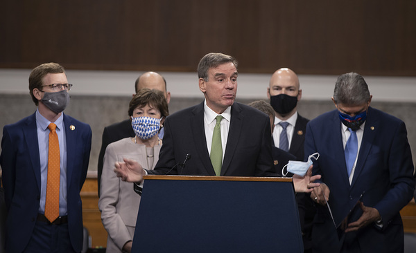 Sen. Mark Warner (D-VA) speaks alongside a bipartisan group of Democrat and Republican members of Congress as they announce a proposal for a $908 billion Covid-19 relief bill on Capitol Hill on Dec. 01, 2020