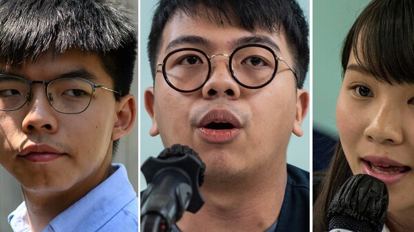 File photos shows Hong Kong pro-democracy activist Joshua Wong, left, activist Ivan Lam (center) and then-student activist Agnes Chow. The three were sentenced in Hong Kong on Wednesday for their roles in leading last year