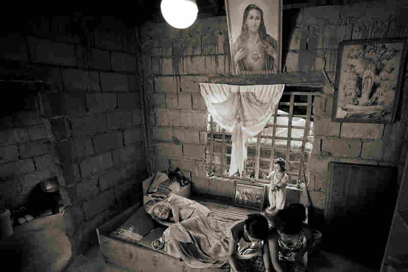 "Juliana dela Cruz, 92, lies at her home in Roxas City on May 27, 2019. She died Sept. 12 of that year. In 1998, she testified: ""At the garrison, they imprisoned me in a room. The cook was the only one who could give me food. The only other ones I saw were the three soldiers who came into my room every night and raped me three to five times a night in the course of one month."""