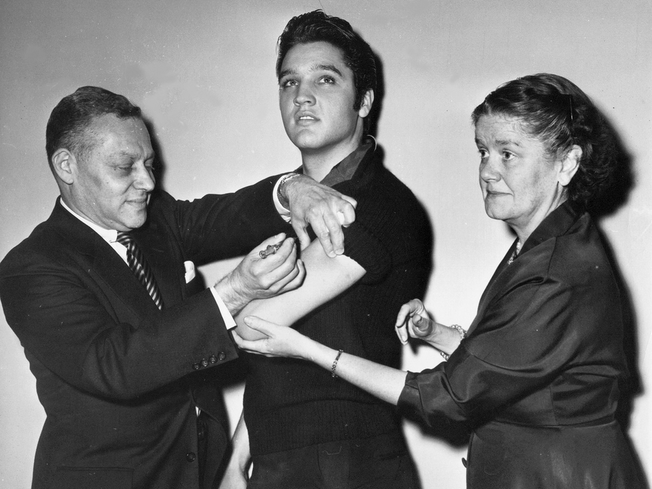 Elvis Presley receives a polio vaccine in New York City in 1956 in an effort to inspire public confidence in the vaccine. The Ad Council says it will be recruiting trusted influencers for its campaign around the coronavirus vaccine. (AP)