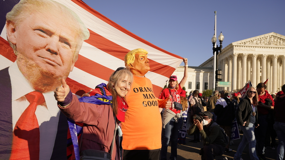 Supporters of President Trump attend pro-Trump marches outside the Supreme Court in Washington on Nov. 14. The Trump team was dealt several losses in multiple courts Friday. (Jacquelyn Martin/AP)