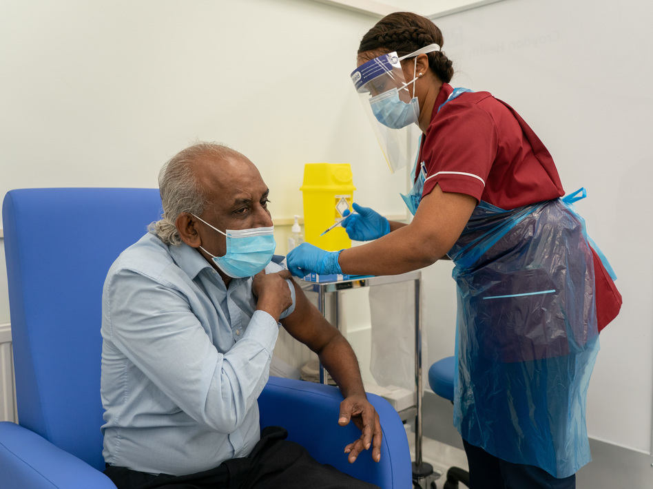 A nurse prepares to administer a COVID-19 vaccine at Croydon University Hospital in London. (Pool/Getty Images)