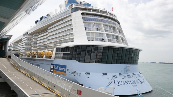 Royal Caribbean said that a guest on the Quantum of the Seas, shown here Wednesday in Singapore, tested positive for coronavirus after checking in with its medical team. The ship returned to port in accordance with government protocols.