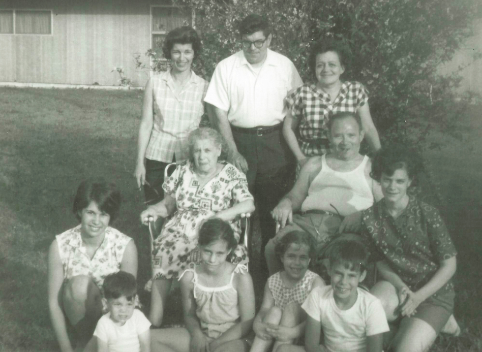 Howard Berkes (seated, front row right) volunteered to be part of a COVID-19 research study this year. He says his family, photographed here in the 1960s, had a history of stepping up during difficult times. That includes his grandparents (in middle), who fled the pogroms of Eastern Europe in the 1920s to raise a family in the United States. (Berkes family)