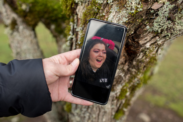 """Kimberly Conger, Sarah McSweeney's nurse at her group home, shows a photo of McSweeney on her phone. She says McSweeney was outgoing and fun: """"She absolutely adored going into malls and getting her makeup done and getting her hair done."""""""