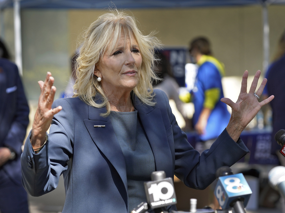 """Jill Biden, on the campaign trail last month in St. Petersburg, Fla., holds two master's degrees and a doctorate in education. An op-ed published in <em>The Wall Street Journal</em> asking her to stop using the title """"Dr."""" has prompted widespread backlash. (Chris O'Meara/AP)"""