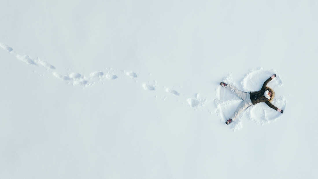 Footsteps and a snow angel in the snow