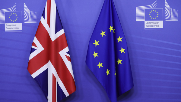 The United Kingdom and European Union flags are at the VIP entrance before the arrival of European Commission President Ursula von der Leyen and British Prime Minister Boris Johnson at EU headquarters in Brussels on Dec. 9.
