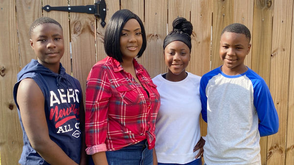 Victoria Gray (second from left) with her three kids, Jamarius Wash, Jadasia Wash and Jaden Wash. Now that the gene-editing treatment has eased Gray