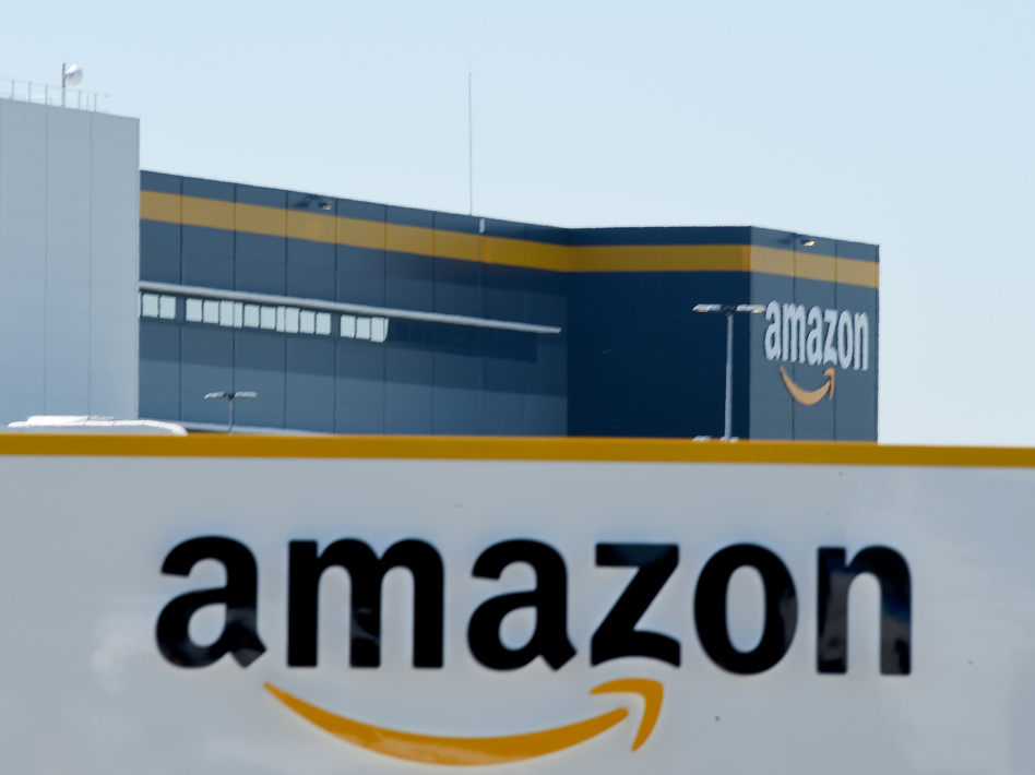 Amazon, and eight other social media and tech companies, received orders from the Federal Trade Commission on Monday. They must hand over information on how they harness user data. (Eric Piermont/AFP/Getty Images)