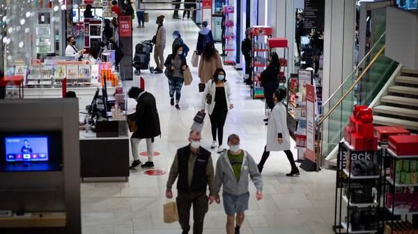 Shoppers walk through Macy