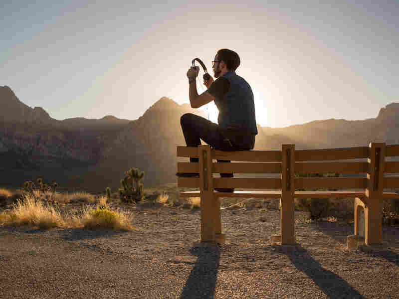Listener Chris Cornelius poses for a photo in Red Rock Canyon National Conservation Area, just outside of Las Vegas, Nevada, on September 21, 2018. (photo by Allison Shelley for NPR)